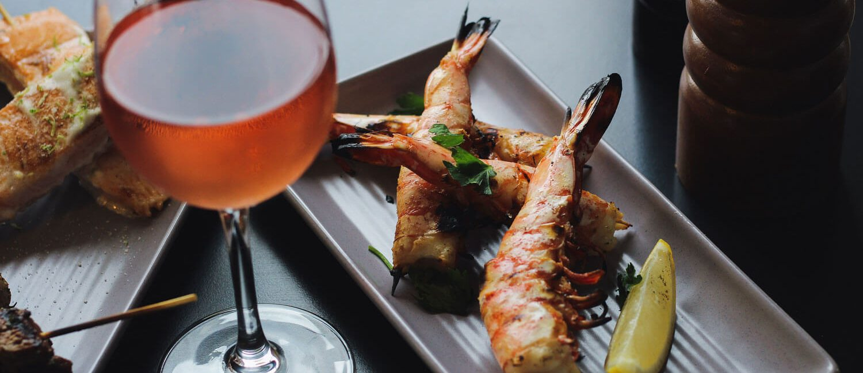 Gazebo-bar-menu--garlic-prawn-skewers-and-wine | Pacific Hotel Brisbane